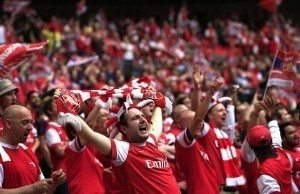 Arsenal fans cheer during the English FA Cup final match between Arsenal and Hull City at Wembly Stadium in London on May 17, 2014. AFP PHOTO/ADRIAN DENNIS NOT FOR MARKETING OR ADVERTISING USE / RESTRICTED TO EDITORIAL USE (Photo credit should read ADRIAN DENNIS/AFP/Getty Images)