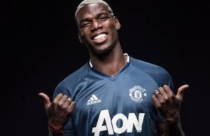 Done Deal: Paul Pogba pictured in a Manchester United shirt