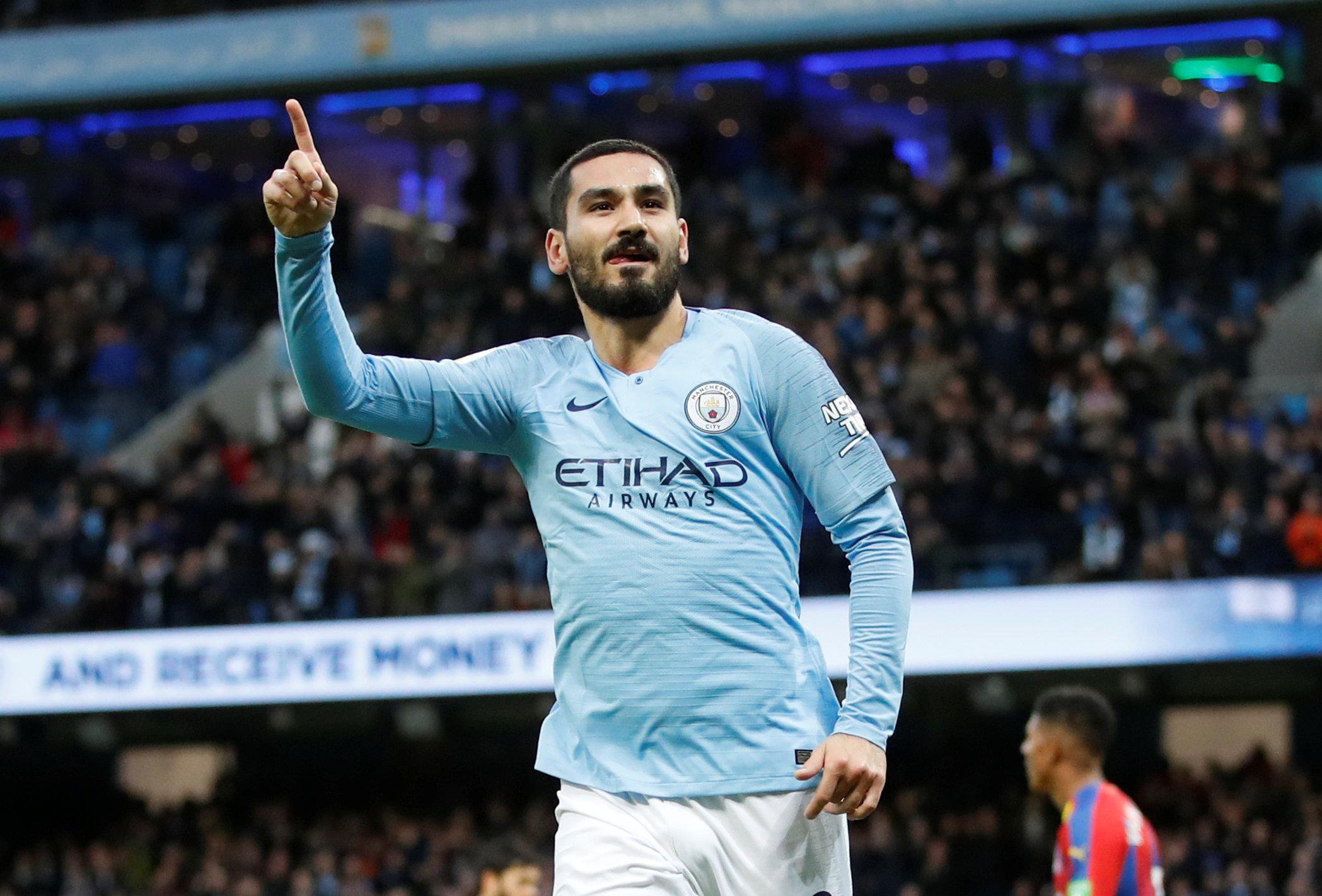 Midfielder Gundogan admits title race is over for Man City